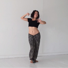 Laurana Wong - Habibi Dah (Nari Narain) - She arches slightly, arms raised at shoulder level, the undulations of her dance showing the curve in her side