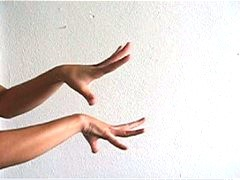 Laurana Wong - Hand Dance - The tanned fingers stretch and curve, dancing one atop one another in white room