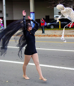 Laurana Wong - Dia De Los Muertos - Arms outstretched and raised to the sky, she is the Raven, bringing change through death