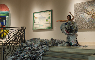 Laurana Wong - The Living (Moving) Sculpture - She stretches upward, clothed in news, an abstraction of dots framing her pose