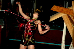 Laurana Wong - Leggo My Ego Act One - She arches back in ecstasy, the rainbow of strings wrapping around her body and entering the audience