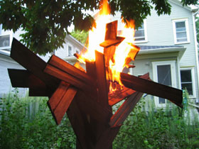 Laurana Wong - Leggo My Ego Act Two - The white hot flames engulf the crisscrossing head of the wooden behemoth