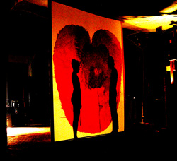 Laurana Wong & Adam Elfers - 1+1=1 - The two silhouettes face off inside the bleeding heart
